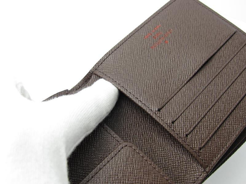 [写真]ルイヴィトンのダミエ エベヌ ポルトフォイユ マルコ 2つ折り財布 N61675 製造番号の場所